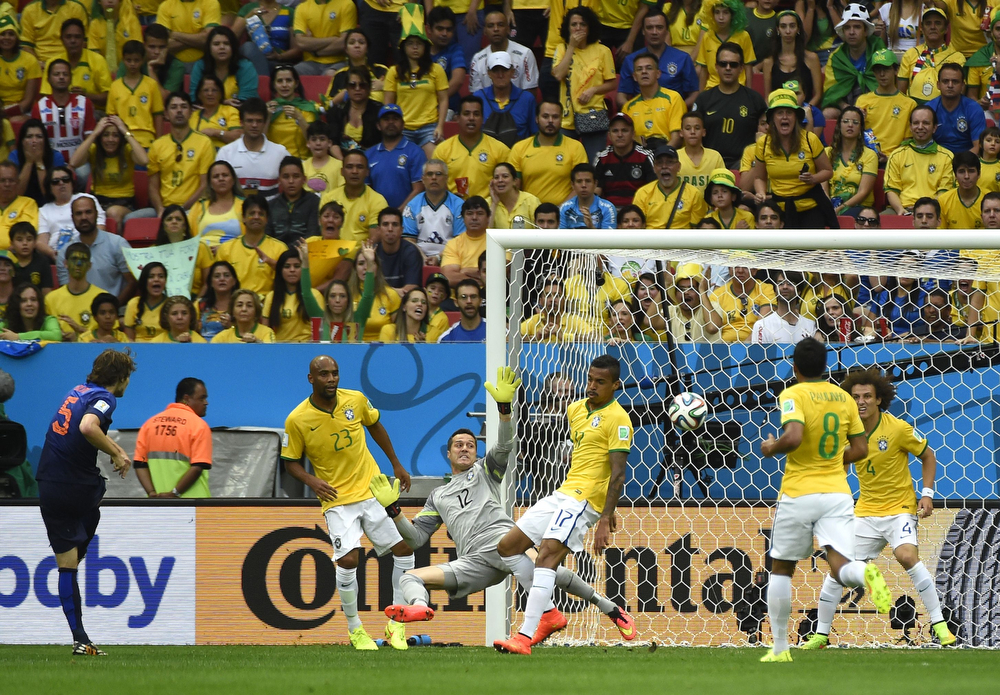 . Netherlands\' defender Daley Blind (L) scores during the third place play-off football match between Brazil and Netherlands during the 2014 FIFA World Cup at the National Stadium in Brasilia on July 12, 2014. (ODD ANDERSEN/AFP/Getty Images)