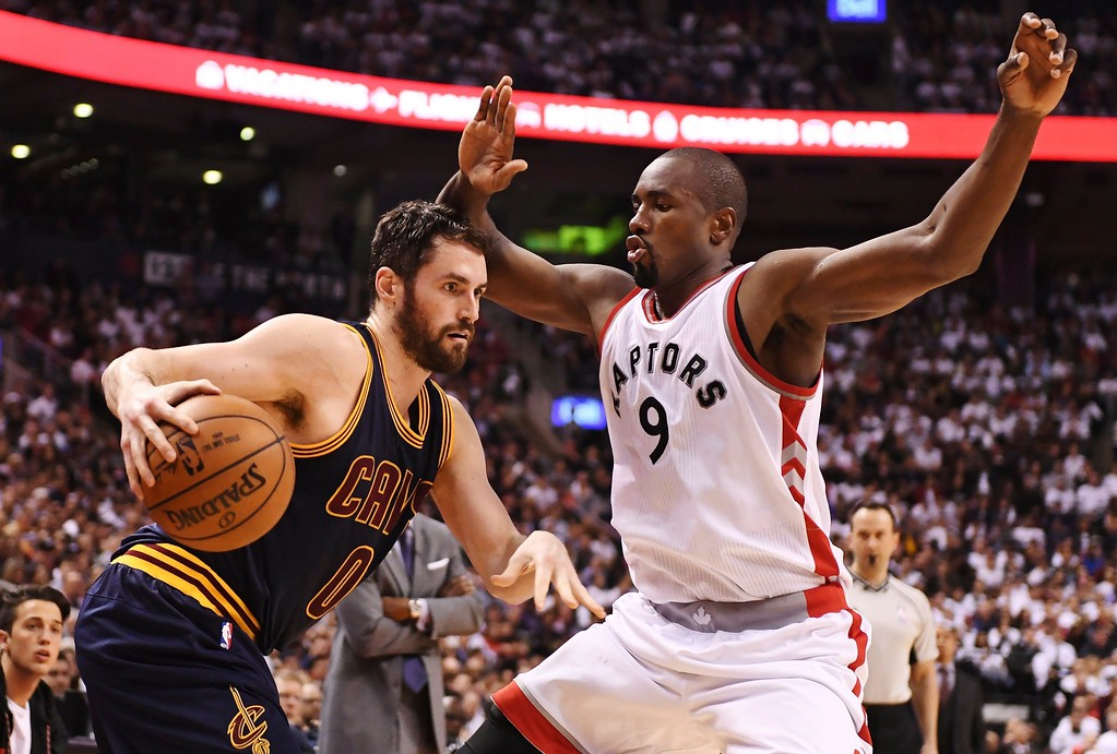 . Cleveland Cavaliers forward Kevin Love (0) protects the ball from Toronto Raptors forward Serge Ibaka (9) during the second half of Game 3 of an NBA basketball second-round playoff series in Toronto on Friday, May 5, 2017. (Frank Gunn/The Canadian Press via AP)