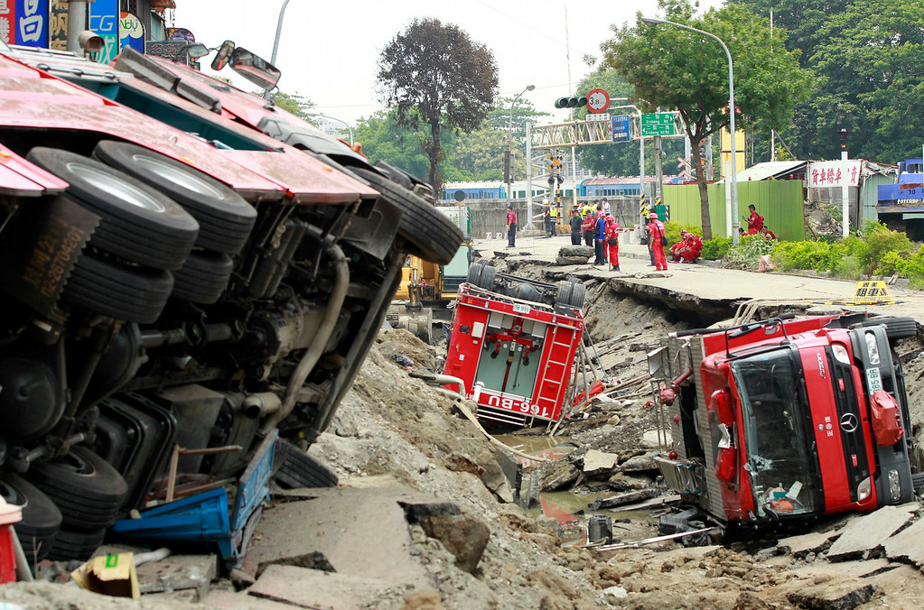 . Damaged firetrucks lie in the rubble after massive gas explosions in Kaohsiung, Taiwan, Friday, Aug. 1, 2014. A series of five explosions about midnight Thursday and early Friday ripped through Taiwan\'s second-largest city, killing scores of people, Taiwan\'s National Fire Agency said Friday. (AP Photo/Wally Santana)
