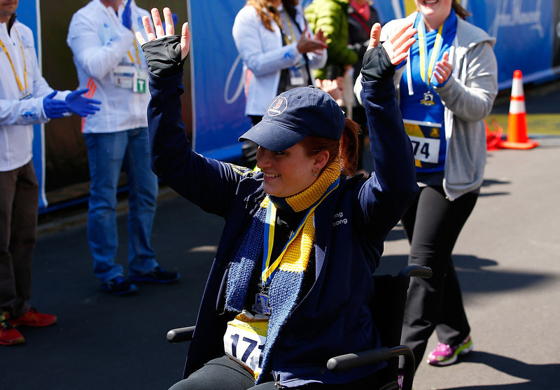 . Kristen Blanck reacts after crossing the Boston Marathon finish line during the B.A.A. Tribute Run on April 19, 2014 in Boston, Massachusetts.  (Photo by Jared Wickerham/Getty Images)