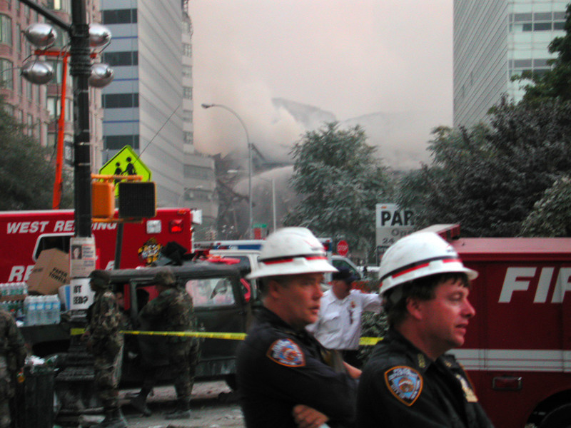 Firemen poor water onto the remains of Building Seven. Building Seven burned and collapsed after a generator diesel tank high in the building caught fire.