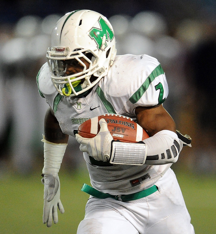 . Monrovia\'s Kurt Scoby runs for a touchdown against San Marino in the first half of a prep football game at Monrovia High School in Monrovia, Calif., on Friday, Nov. 8, 2013.    (Keith Birmingham Pasadena Star-News)