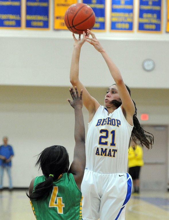 . Bishop Amat\'s Paulina Santana (21) shoots over Long Beach Poly\'s Tania Lamb (4) in the second half of a CIF State Southern California Regional semifinal basketball game at Bishop Amat High School on Tuesday, March 12, 2013 in La Puente, Calif. Long Beach Poly won 52-34.  (Keith Birmingham Pasadena Star-News)