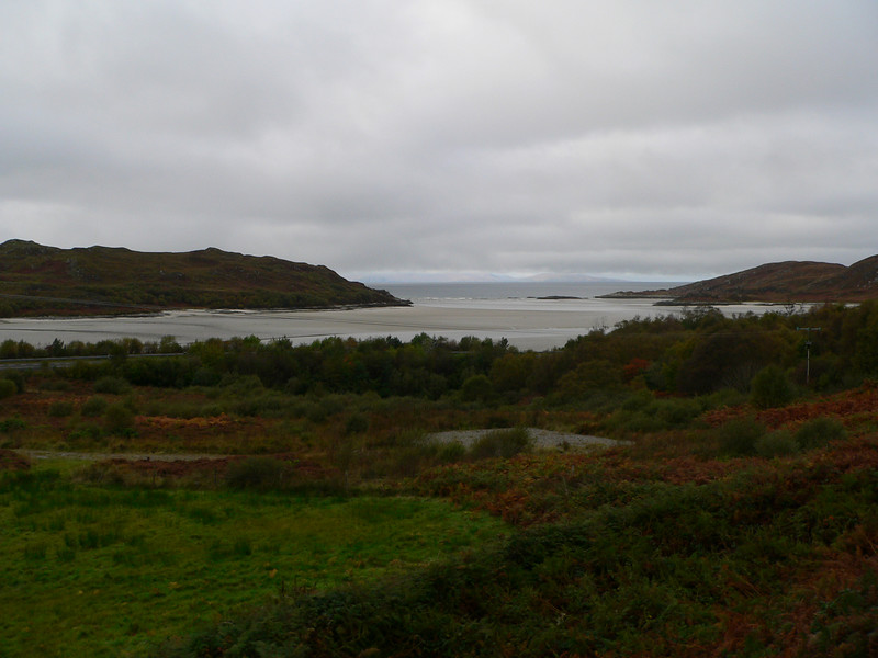 """Morar (Big Water), 38 miles along on the train journey. """"Morar, famous for its white sands, is where """"Local Hero"""" and """"Highlander"""" were filmed. Hidden by treas on the right side of the train (not shown) is Loch Morar, at 1,080 ft the deepest inland loch in Britain and home to a monster (""""Morag"""", a cousin to """"Nessie"""")."""