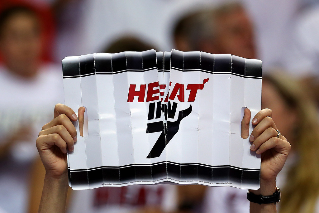 ". A fan of the Miami Heat holds up a sign which reads ""Heat in 7\"" in the second half against the Indiana Pacers during Game Seven of the Eastern Conference Finals of the 2013 NBA Playoffs at AmericanAirlines Arena on June 3, 2013 in Miami, Florida.    (Photo by Mike Ehrmann/Getty Images)"