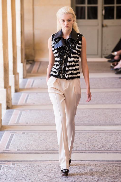 . A model walks the runway during the Bouchra Jarrar show as part of Paris Fashion Week - Haute Couture Fall/Winter 2014-2015 at Lycee Henri IV on July 8, 2014 in Paris, France.  (Photo by Francois Durand/Getty Images)