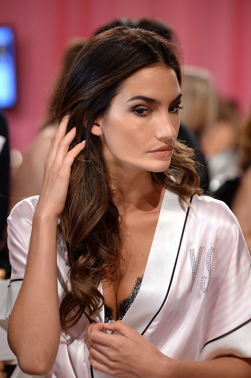 . Model Lily Aldridge prepares at the 2013 Victoria\'s Secret Fashion Show hair and make-up room at Lexington Avenue Armory on November 13, 2013 in New York City.  (Photo by Dimitrios Kambouris/Getty Images for Victoria\'s Secret)