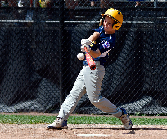 8/10/2019 Mike Orazzi | Staff Rhode Islands Barrington Little League's Owen Pfeffer (13) drives in some runs during a win Saturday over New Hampshires Goffstown Junior Baseball Little League at Breen Field in Bristol, Conn., during the New England Regional and advancing to the Little League World Series in Williamsport PA.