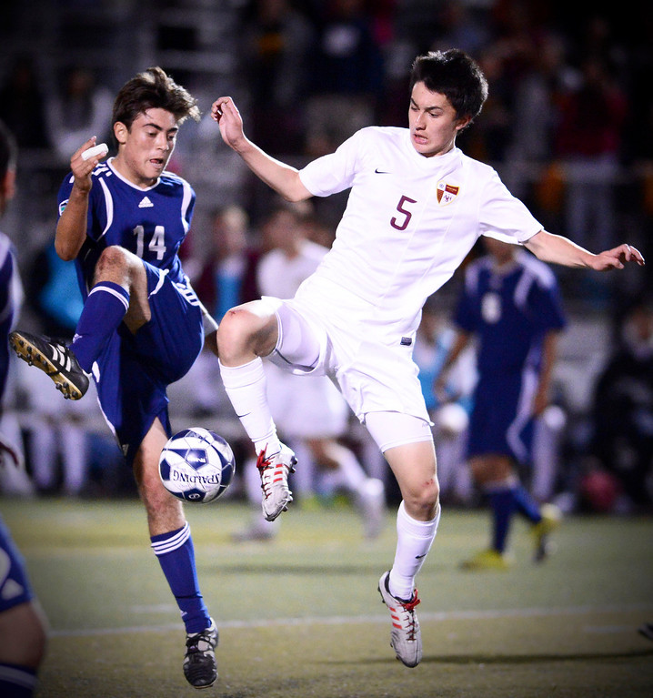 . Arcadia\'s Forrest Hoffman (5) drives the ball as Anaheim\'s Alex Supancic (14) approaches during the quarterfinals at Arcadia High School Thursday, February 27, 2014. Arcadia was defeated 2-0. (Photo by Sarah Reingewirtz/Pasadena Star-News)