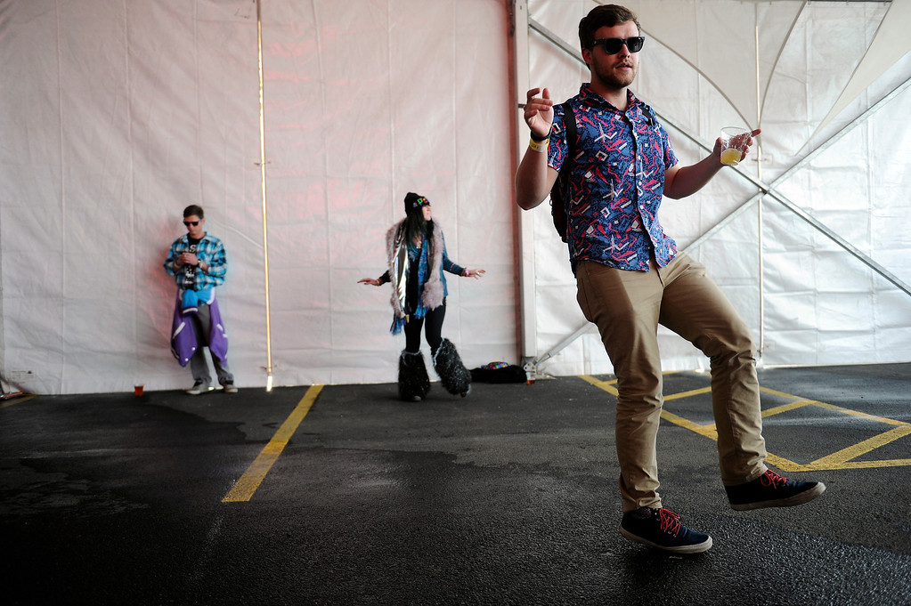 . DENVER, CO - APRIL 4: Fans dance as Real Magic performs during the Snowball Music Festival at Sports Authority Field at Mile High Stadium on April 4, 2014 in Denver, Colorado. The Snowball Music Festival is celebrating its first year in Denver after spending the previous three years as a mountain based festival. (Photo by Seth McConnell/The Denver Post)