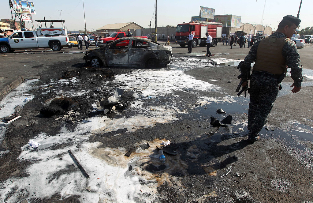. A member of the Iraqi security forces monitors the site of a car bomb explosion in the New Baghdad district, killing at least 12 people and wounding dozens on September 10, 2014, as US Secretary of State visited the Iraqi capital for talks on combating jihadists. A suicide car bombing followed by a car bomb struck near a police checkpoint in a crowded area of eastern Baghdad, officials said. AFP PHOTO / AHMAD AL-RUBAYEAHMAD AL-RUBAYE/AFP/Getty Images