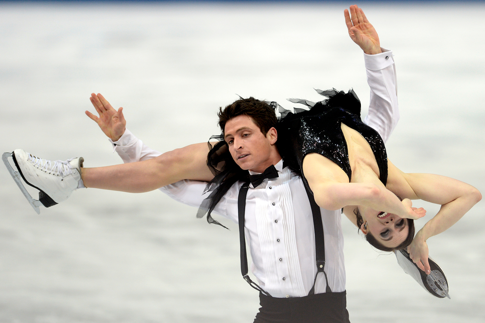 . Canada\'s Scott Moir and Tessa Virtue perform en route to a 72.98 in ice dance short during team figure skating. Sochi 2014 Winter Olympics on Saturday, February 8, 2014. (Photo by AAron Ontiveroz/The Denver Post)