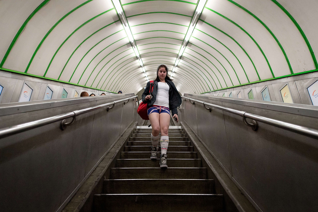 """. A participant in the13th annual International \""""No Pants Subway Ride\"""" enters a London underground station in London, on January 12, 2014. Starting in 2002 with only seven participants, the day is now marked in over 60 cities around the world.  The idea behind \""""No Pants\"""" is that random passengers board a subway car at separate stops in the middle of winter, without wearing trousers. The participants wear all of the usual winter clothing on their top half such as hats, scarves and gloves and do not acknowledge each other\'s similar state of undress. LEON NEAL/AFP/Getty Images"""