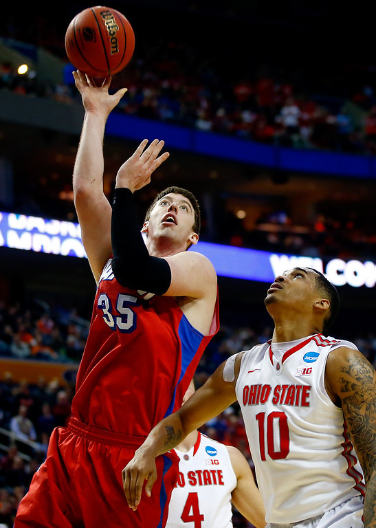 . Matt Kavanaugh #35 of the Dayton Flyers goes up for a shot against LaQuinton Ross #10 of the Ohio State Buckeyes during the second round of the 2014 NCAA Men\'s Basketball Tournament at the First Niagara Center on March 20, 2014 in Buffalo, New York.  (Photo by Jared Wickerham/Getty Images)