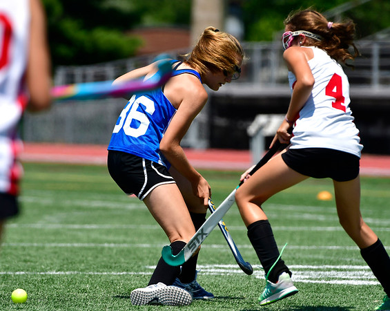 7/19/2019 Mike Orazzi | Staff Simsbury U15 Field Hockey's Charlotte Iler (36) and Fairfield County United's Margo Stanley (4) team during the Nutmeg Games at Veterans Stadium in New Britain on Friday.