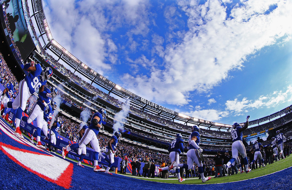 . The New York Giants run onto the field prior to their game against the Oakland Raiders during their game at MetLife Stadium on November 10, 2013 in East Rutherford, New Jersey.  (Photo by Al Bello/Getty Images)