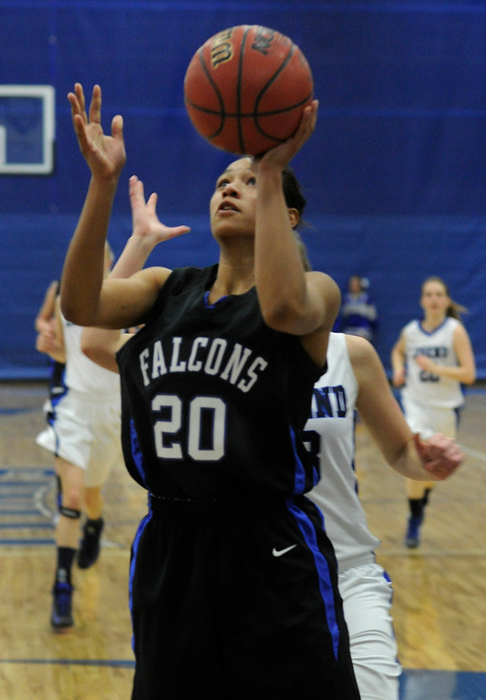 . PARKER, CO. - FEBRUARY 15: Falcons point guard Ciera Morgan (20) had a clear shot underneath in the second half. The Highlands Ranch High School girls\'s basketball team defeated Legend 76-31 Friday night, February 15, 2013. Falcon\'s coach Caryn Jarocki earned her 500th career win. (Photo By Karl Gehring/The Denver Post)