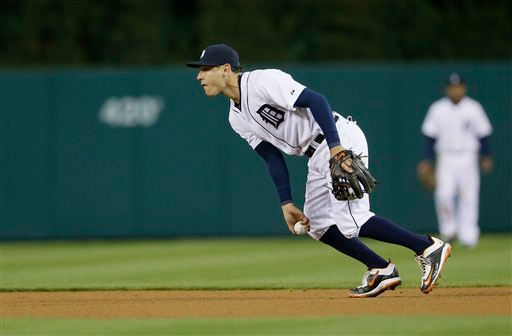 . Detroit Tigers second baseman Ian Kinsler tosses the ball to Detroit Tigers shortstop Jose Iglesias for the out on New York Yankees\' Alex Rodriguez during the sixth inning of a baseball game, Tuesday, April 21, 2015, in Detroit. (AP Photo/Carlos Osorio)
