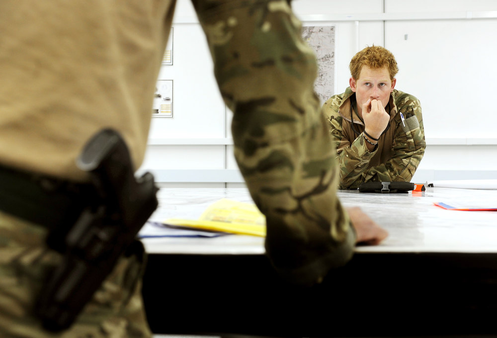 Description of . In this image released on January 22, 2013, Prince Harry, attends a mission briefing at the British controlled flight-line at Camp Bastion on October 31, 2012 in Afghanistan. Prince Harry has served as an Apache Helicopter Pilot/Gunner with 662 Sqd Army Air Corps, from September 2012 for four months until January 2013.  (Photo by John Stillwell - WPA Pool/Getty Images)