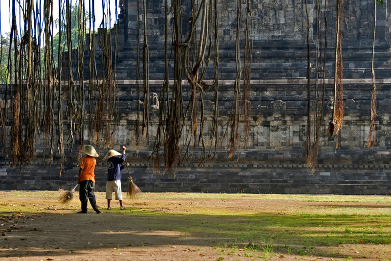 Workers sweeping in front of the temple at Prambanan in Jakarta, Indonesia