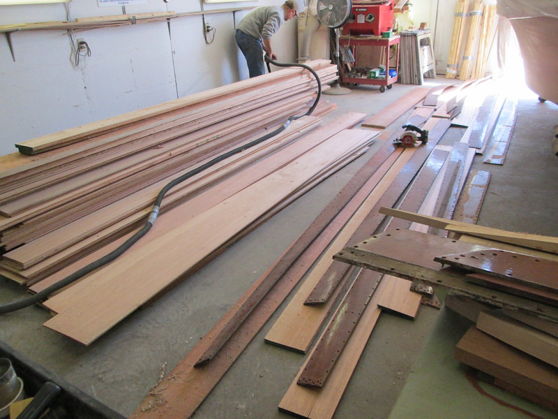 Sorting wood for side planks.