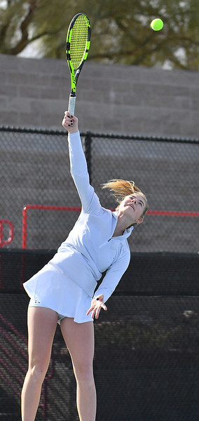 LAS VEGAS, NV - JANUARY 20:  Quinty Janssen of the New Mexico State Aggies serves during her match against Morgan Dickason of the Weber State Wildcats at the Frank and Vicki Fertitta Tennis Complex in Las Vegas, Nevada. Janssen won the match 4-6, 6-0, 6-3.