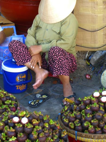 Mangosteen Vendor taking a Nap - Ho Chi Minh City, Vietnam