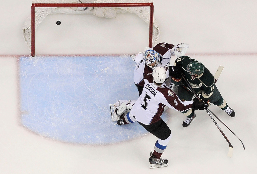 . Minnesota Wild left wing Zach Parise (11) looks back at the goal as he scores the games first goal on Colorado Avalanche goalie Semyon Varlamov (1) and Colorado Avalanche defenseman Nate Guenin (5) on defense during the first period  April 28, 2014 in Game 6 of the Stanley Cup Playoffs at Xcel Energy Center.  (Photo by John Leyba/The Denver Post)