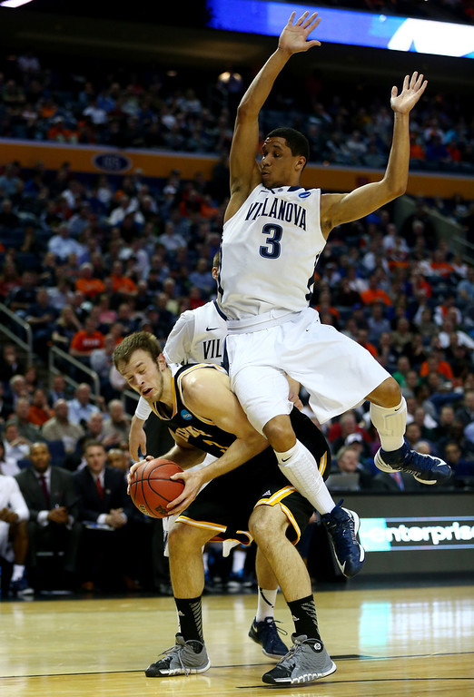 . BUFFALO, NY - MARCH 20: Josh Hart #3 of the Villanova Wildcats collides with Kyle Kelm #3 of the Milwaukee Panthers during the second round of the 2014 NCAA Men\'s Basketball Tournament at the First Niagara Center on March 20, 2014 in Buffalo, New York.  (Photo by Elsa/Getty Images)