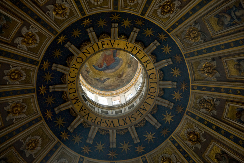 Looking up the dome inside St Peter's Basilica in Vatican City