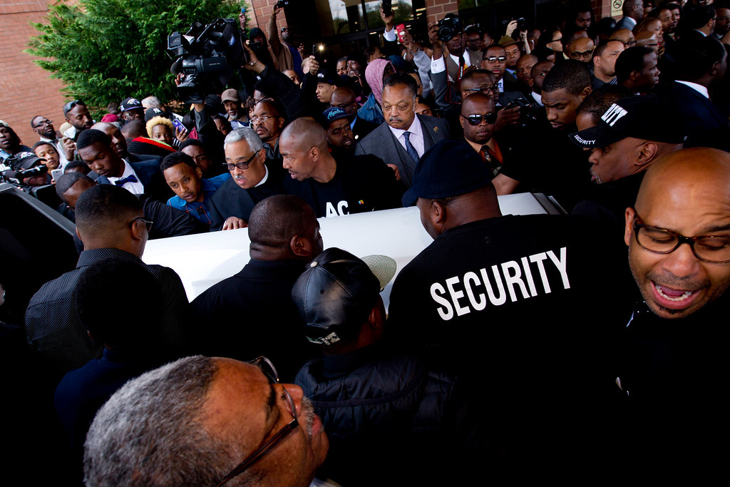 . Mourners and supporters carry the casket of Freddie Gray, after his funeral on Monday, April 27, 2015, at New Shiloh Baptist Church in Baltimore. Gray died from spinal injuries about a week after he was arrested and transported in a Baltimore Police Department van.  (AP Photo/Jose Luis Magana)