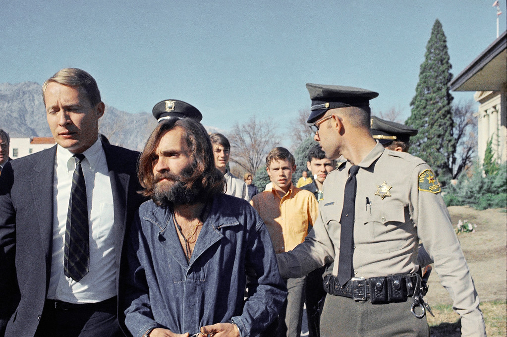 . Charles Manson, leader of a hippie cult linked to the Sharon Tate murders, strides from jail to courtroom at Independence, Calif., Dec. 3, 1969, for a preliminary hearing on charges of possessing stolen property. (AP Photo)