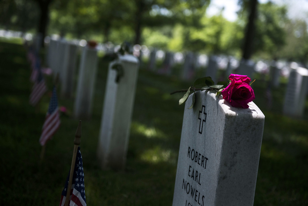 . A flower sits on a headstone on Memorial Day in Section 60 at Arlington National Cemetery on May 25, 2015 in Arlington, Va. U.S. President Barack Obama, Chairman of the Joint Chiefs of Staff U.S. Army General Martin Dempsey and U.S. Defense Secretary Ash Carter honored fallen soldiers during a ceremony at Arlington on this Memorial Day.  (Photo by Gabriella Demczuk/Getty Images)