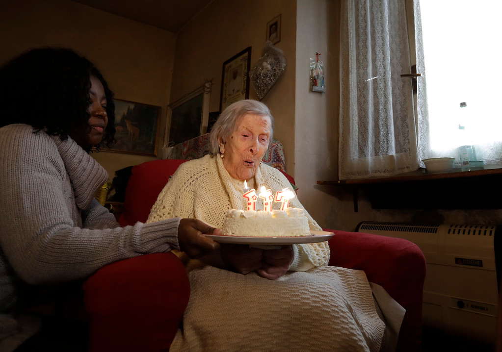 . Emma Morano, 117 years old, blows candles in the day of her birthday in Verbania, Italy, Tuesday, Nov. 29, 2016.  At 117 years of age, Emma is now the oldest person in the world and is believed to be the last surviving person in the world who was born in the 1800s, coming into the world on Nov. 29, 1899. (AP Photo/Antonio Calanni)