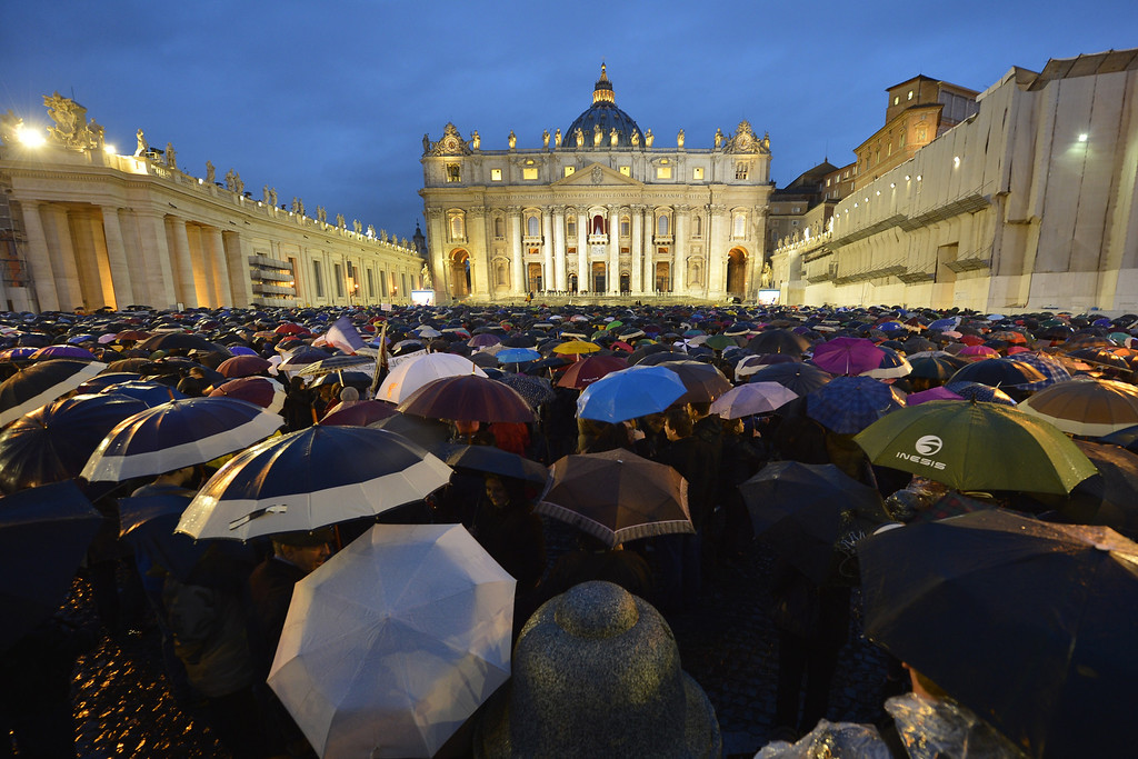 . Faithful wait for the smoke announcing the result on the second day of the papal election conclave on March 13, 2013 at the Vatican.  AFP PHOTO / ANDREAS SOLARO/AFP/Getty Images