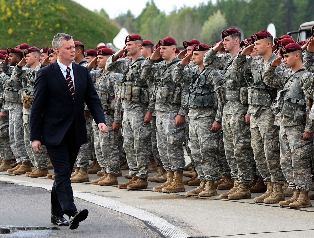. Polish Defence Minister Tomasz Siemoniak walks in front of the first American troops arrived in Poland to Swidwin on April 23, 2014, after Washington said it was sending a force of 600 to the Baltic states as the crisis over Ukraine deepens . (JANEK SKARZYNSKI/AFP/Getty Images)