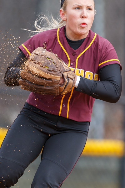 Sheehan's third basemen Becca Souza (13) scopes up the ball and some dirt on a short hit from Amity's Dani Nordyk (7) Thursday at Amity Regional High School in Woodbridge Apr. 23, 2015 | Justin Weekes / For the Record-Journal