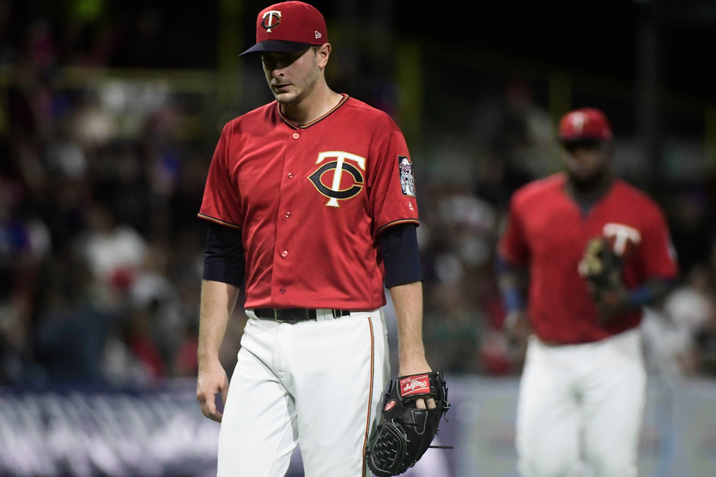 . Minnesota Twins starting pitcher Jake Odorizzi leaves the mound after throwing to the Cincinnati Indians during the first inning of game one of a two-game MLB Series at Hiram Bithorn Stadium in San Juan, Puerto Rico, Tuesday, April 17, 2018. (AP Photo/Carlos Giusti)