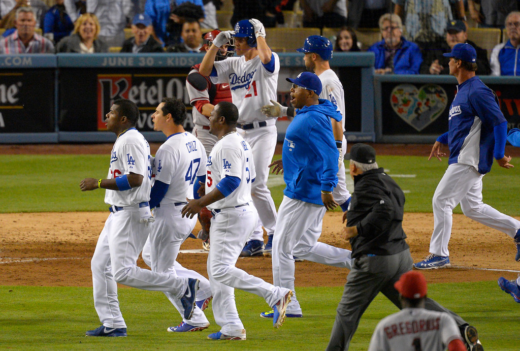 . Members of the Los Angeles Dodgers and the Arizona Diamondbacks run on to the field during a scuffle in the seventh inning of their baseball game, Tuesday, June 11, 2013, in Los Angeles.  (AP Photo/Mark J. Terrill)