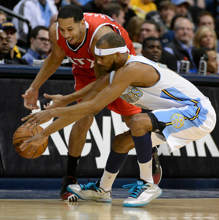 . Corey Brewer (13) of the Denver Nuggets goes after a loose ball with Devin Harris (34) of the Atlanta Hawks March 4,  2013 at Pepsi Center. (Photo By John Leyba/The Denver Post)