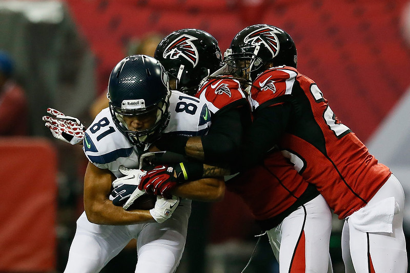 . Golden Tate #81 of the Seattle Seahawks catches a reception against  Dunta Robinson #23 and  Thomas DeCoud #28 of the Atlanta Falcons in the second quarter during the NFC Divisional Playoff Game at Georgia Dome on January 13, 2013 in Atlanta, Georgia.  (Photo by Kevin C. Cox/Getty Images)