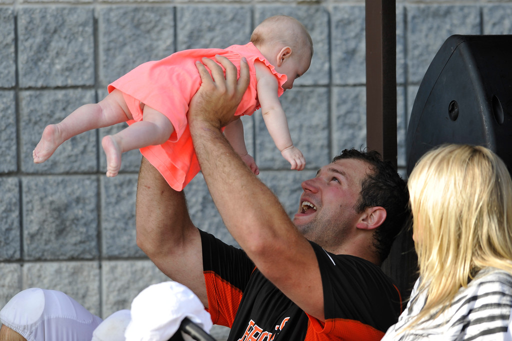 . Cleveland Browns offensive lineman Joe Thomas holds his daughter Logan after practice during training camp at the NFL football team\'s facility in Berea, Ohio Wednesday, July 31, 2013. (AP Photo/David Richard)