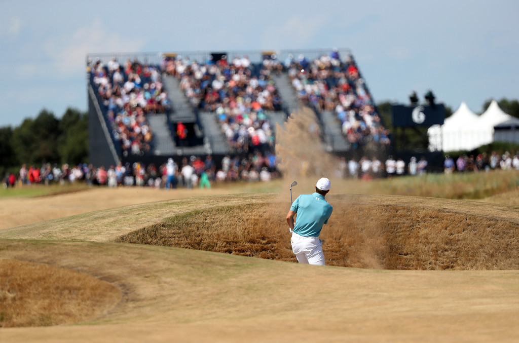 . Jordan Spieth of the US plays out of a bunker on the 6th hole during the first round of the British Open Golf Championship in Carnoustie, Scotland, Thursday July 19, 2018. (AP Photo/Peter Morrison)
