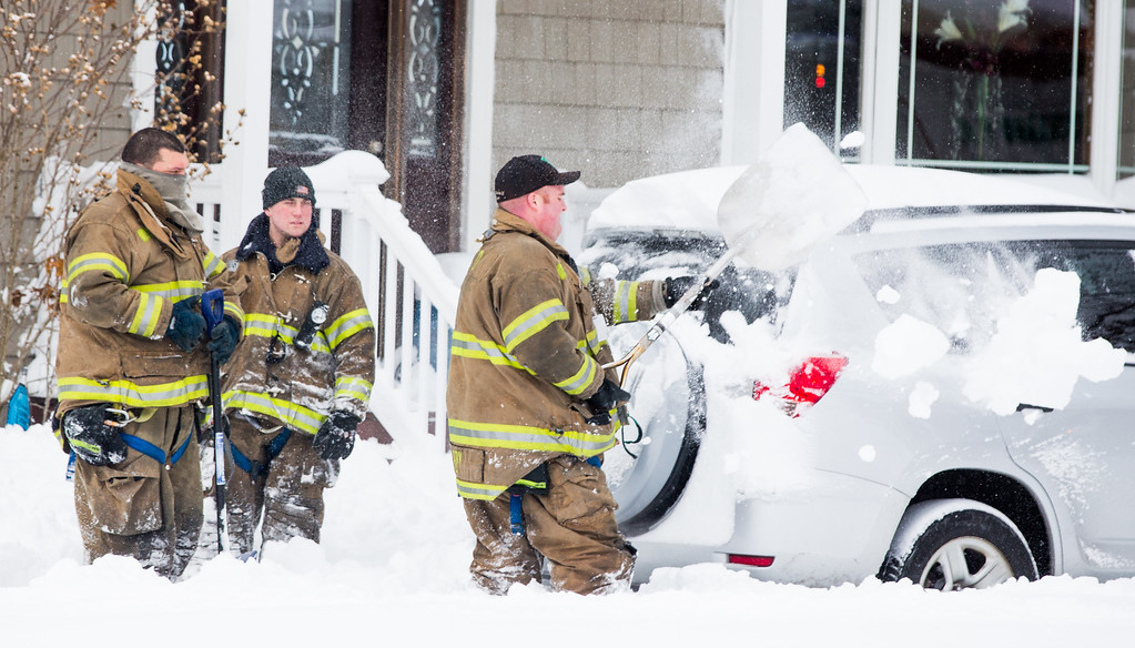 . The Centereach Fire Department helps shovel a driveway and the road  following a major snow storm January 27, 2015 in Centerreach, New York. Much of the Northeast was hit with heavy overnight snow from Winter Storm Juno.  (Photo by Andrew Theodorakis/Getty Images)