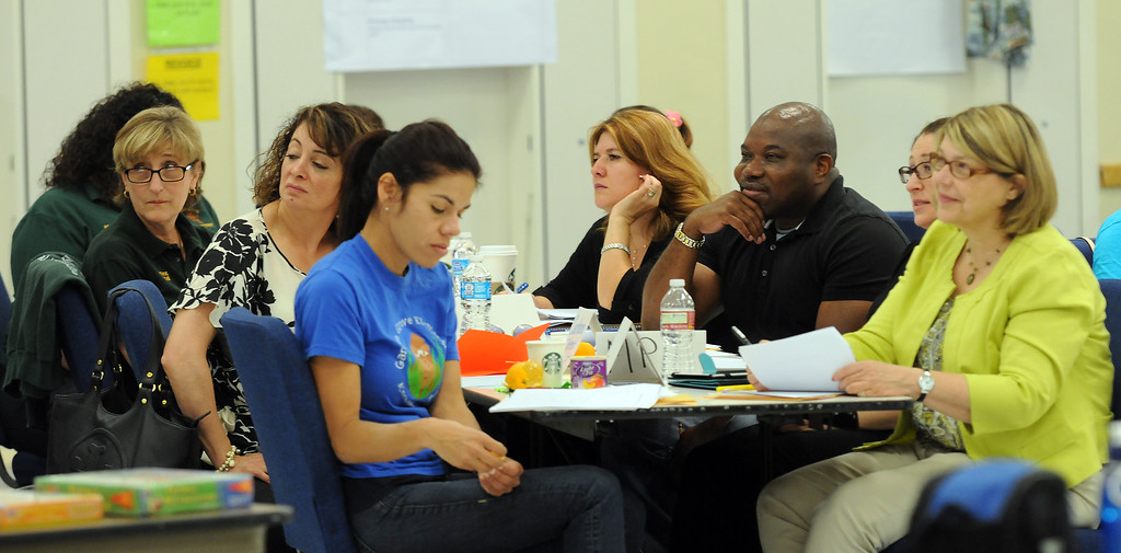 . Educators work on a project during a training session at Holmes Middle School in Northridge, CA on June 21, 2013.  School districts are planning for the Common Core, the nationwide curriculum that will be implemented in Fall 2014.  (Dean Musgrove/Los Angeles Daily News)
