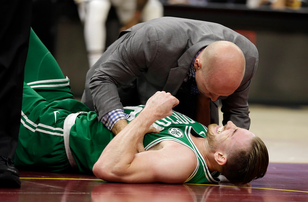 . Boston Celtics\' Gordon Hayward grimaces in pain in the first half of an NBA basketball game against the Cleveland Cavaliers, Tuesday, Oct. 17, 2017, in Cleveland. Just five minutes into his Boston career, new Celtics star forward Gordon Hayward gruesomely broke his left ankle, an injury that may end his season. (AP Photo/Tony Dejak)