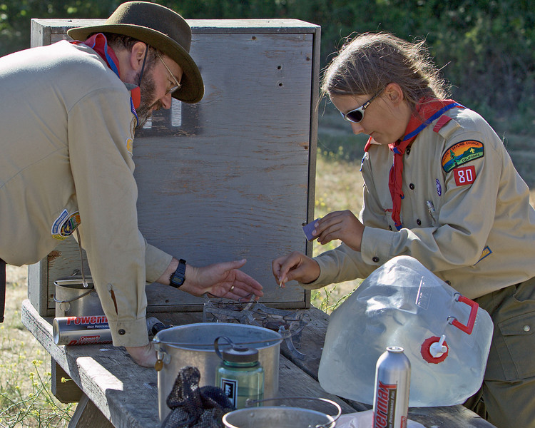 Mr. R. shows David tricks for lighting the camp stove in windy conditions.