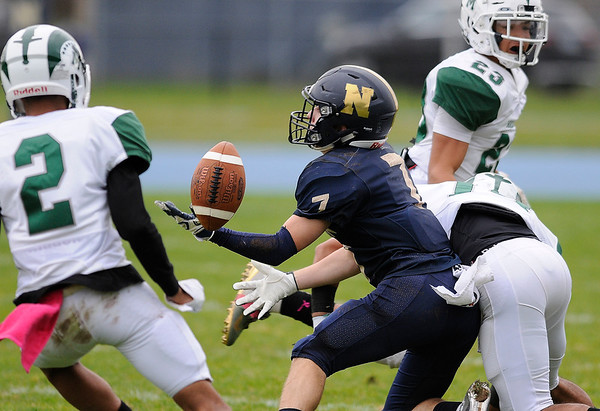 10/25/2019 Mike Orazzi | StaffrNewington High Schools Jordan Alexander r(7) bobbles a pass during Friday afternoons football game with Maloney High School in Newington. r