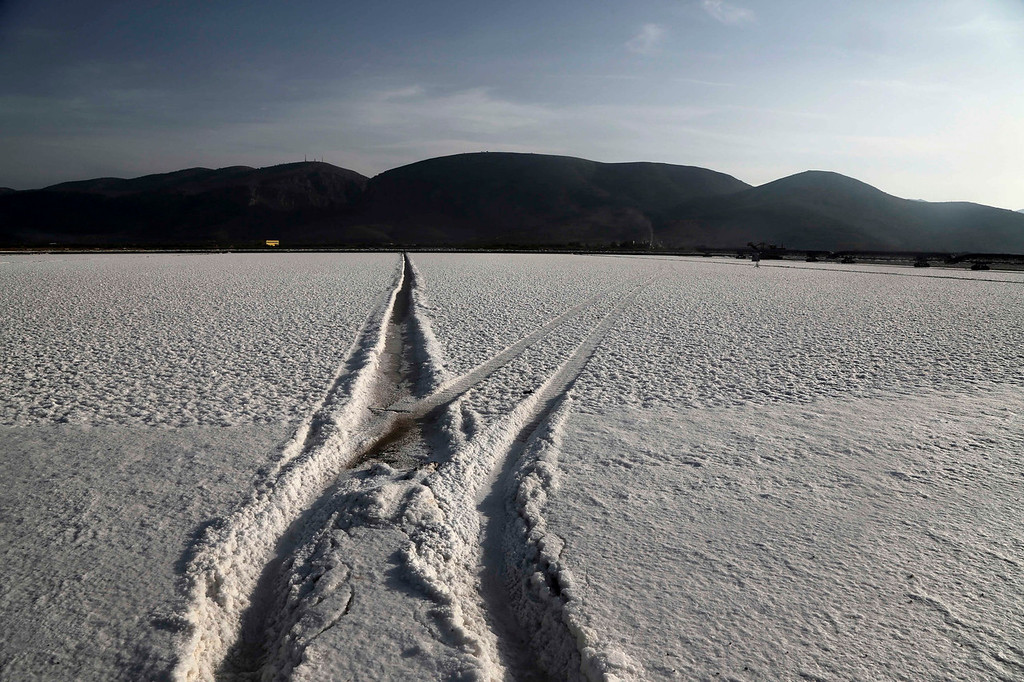 . Wheel traces on the salt are seen at a production site in Messolongi, western Greece. The facilities at the site are the largest saltworks in Greece, and are located at a protected wetland complex of estuaries and lagoons. (AP Photo/Dimitri Messinis)