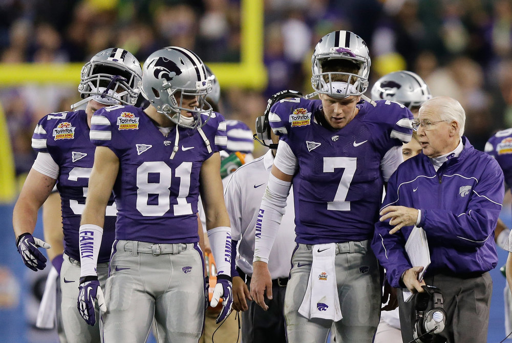 Description of . Head coach Bill Snyder talks to Collin Klein #7 of the Kansas State Wildcats during the Tostitos Fiesta Bowl against the Oregon Ducks at University of Phoenix Stadium on January 3, 2013 in Glendale, Arizona.  (Photo by Ezra Shaw/Getty Images)